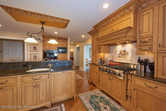The kitchen features a granite stone counter a breakfast center and a Butler Pantry.
