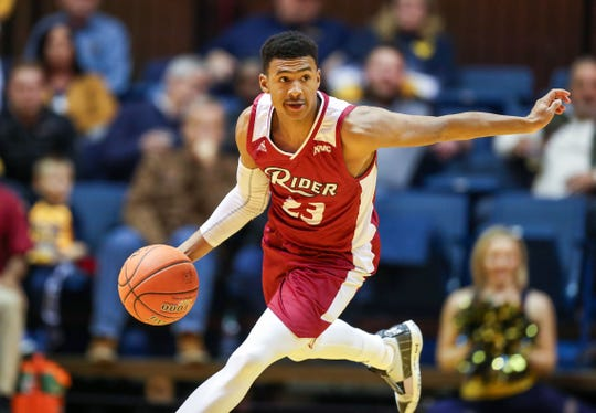 Rider Broncs guard Stevie Jordan (23) dribbles the ball up the floor during the first half against the West Virginia Mountaineers