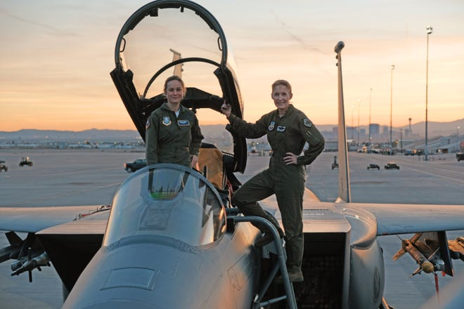 """Brie Larson (left) gets hands-on help from Brigadier Gen. Jeannie Leavitt, 57th Wing commander (right), on a recent trip to Nellis Air Force Base in Nevada to research her character, Carol Danvers aka Captain Marvel, for Marvel Studios' """"Captain Marvel."""""""