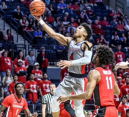 Mississippi guard Breein Tyree (4) shoots against Georgia's Christian Harrison (11) during an NCAA college basketball game in Oxford, Miss., Saturday, Feb. 23, 2019.