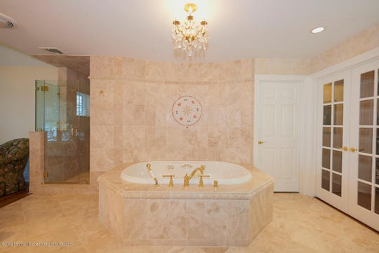 The Master bath features  double sinks, marble shower stall and whirlpool and walk-in-closet.