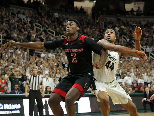Rutgers Scarlet Knights center Shaquille Doorson (2) and Michigan State Spartans forward Nick Ward (44) fight for position
