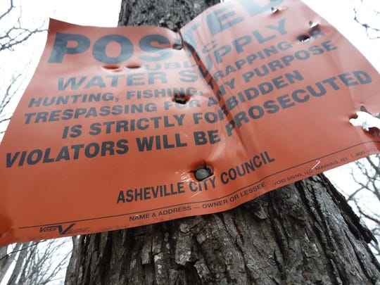 A sign warning people to stay out of Asheville watershed property.