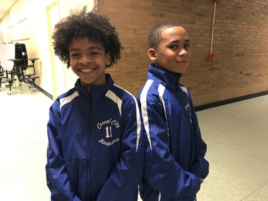 Avin Hawkins and Kenyon Clark show off their new Cereal City Hoopsters warmups, designed by Bryan Tarrant and paid for by the Herman Moore Tackle Life Foundation.