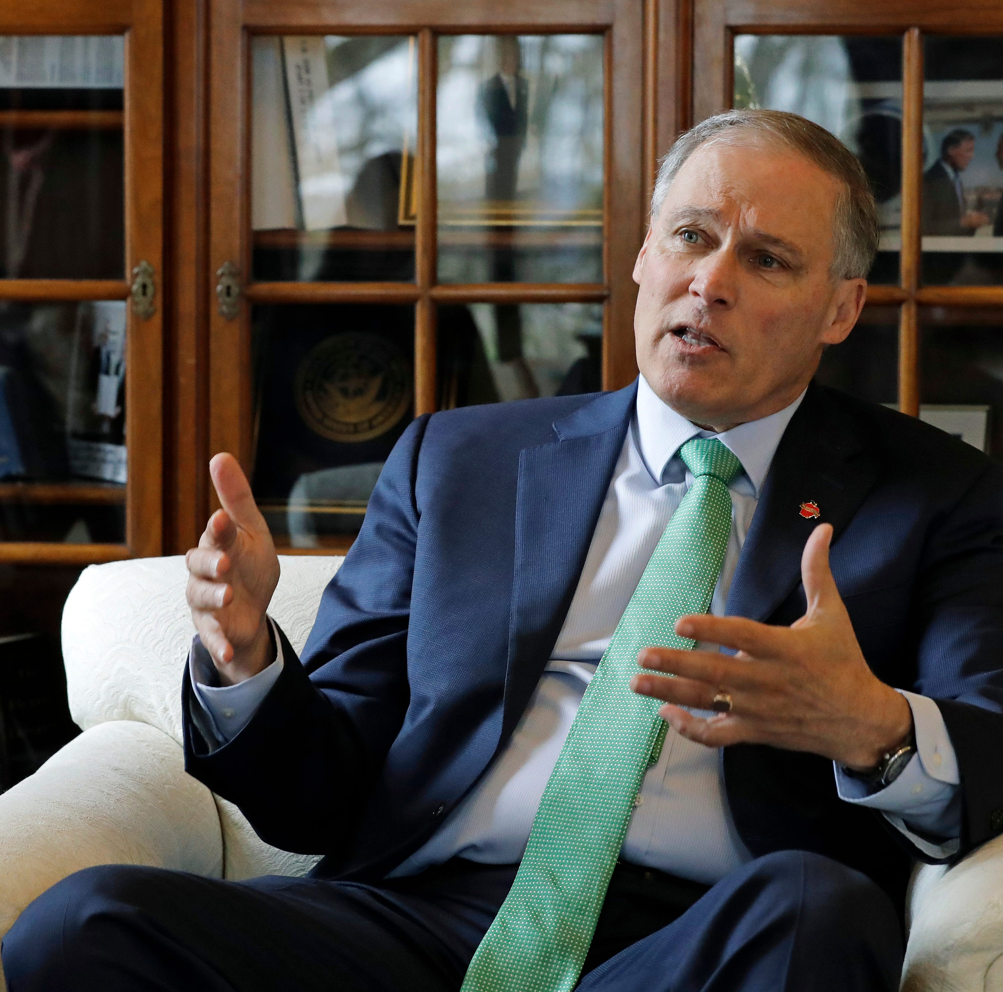 Inslee eyes national climate fight, has struggled at home