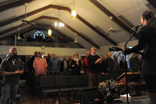 Mandy Holbert, the worship team leader for The Ridge Church, leads the gathering with a song on March 3.