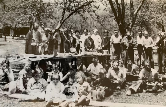 This photo was taken during  a lunch break in 1934, when members of the Ridgecrest community gathered to build Ridgecrest Baptist Church.