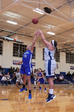 Montreat's Darah DeWalt shoots over a defender during a home game this season. The senior became the 15th player in the program's history to top the 1,000-point mark for her career on Feb. 16.