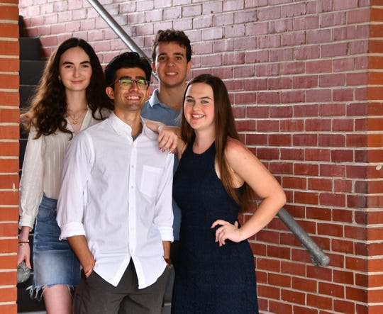Ishaar Jathal and Lena Hatter, front; and Sarah Paylor and Josh Freeman, back, students at Westshore Jr./Sr. High School, are helping fund a Habitat for Humanity house for their school project.