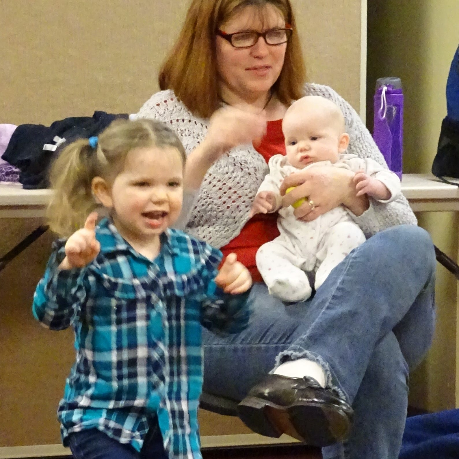 Preschoolers move to the music at library program
