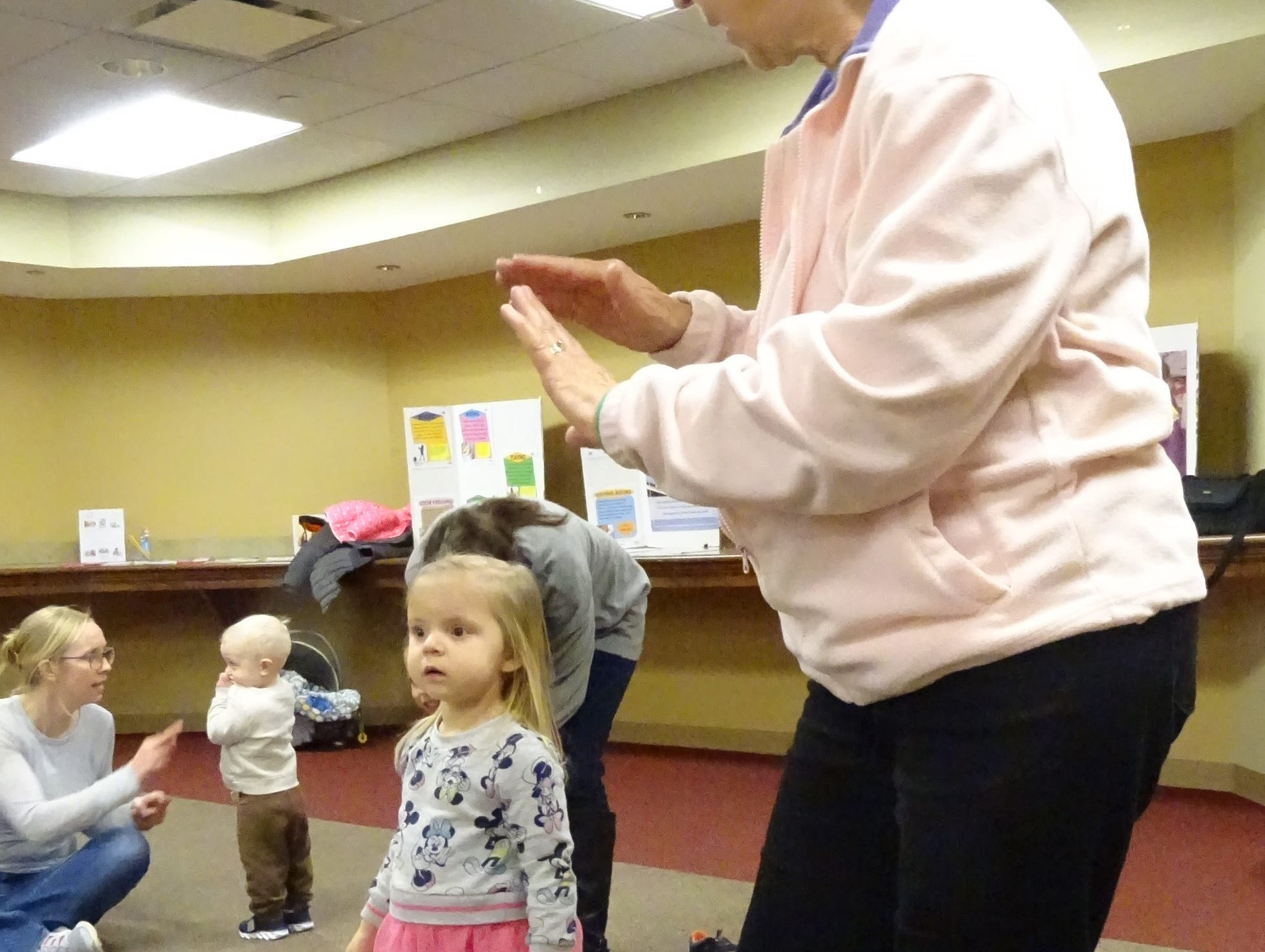 Linda Meadows dances with granddaughter Elaina Plymale, 3,  during Music, Movement and More at the Bucyrus Public Library on Monday.