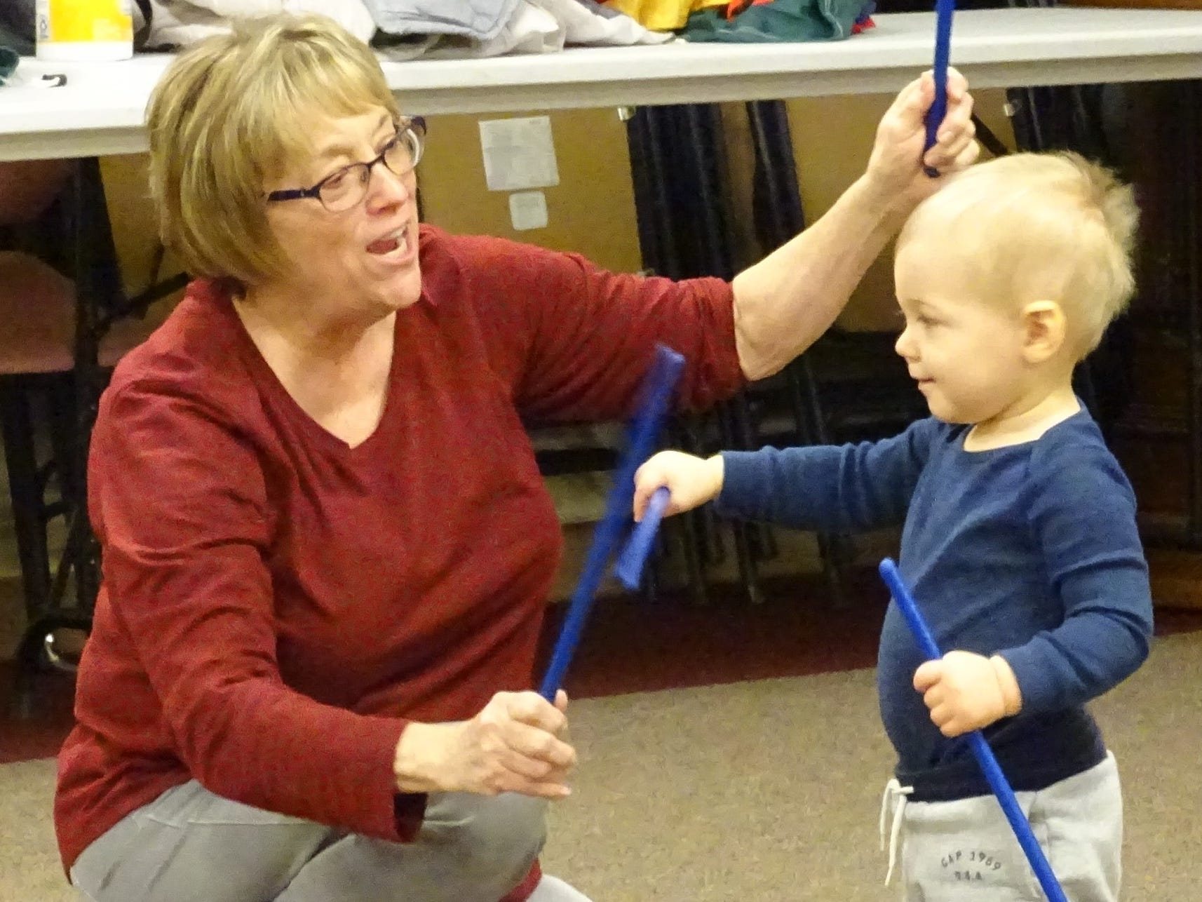 Lin Bils makes music with Zeb Klamforth, 1, during Music, Movement and More at the Bucyrus Public Library on Monday.