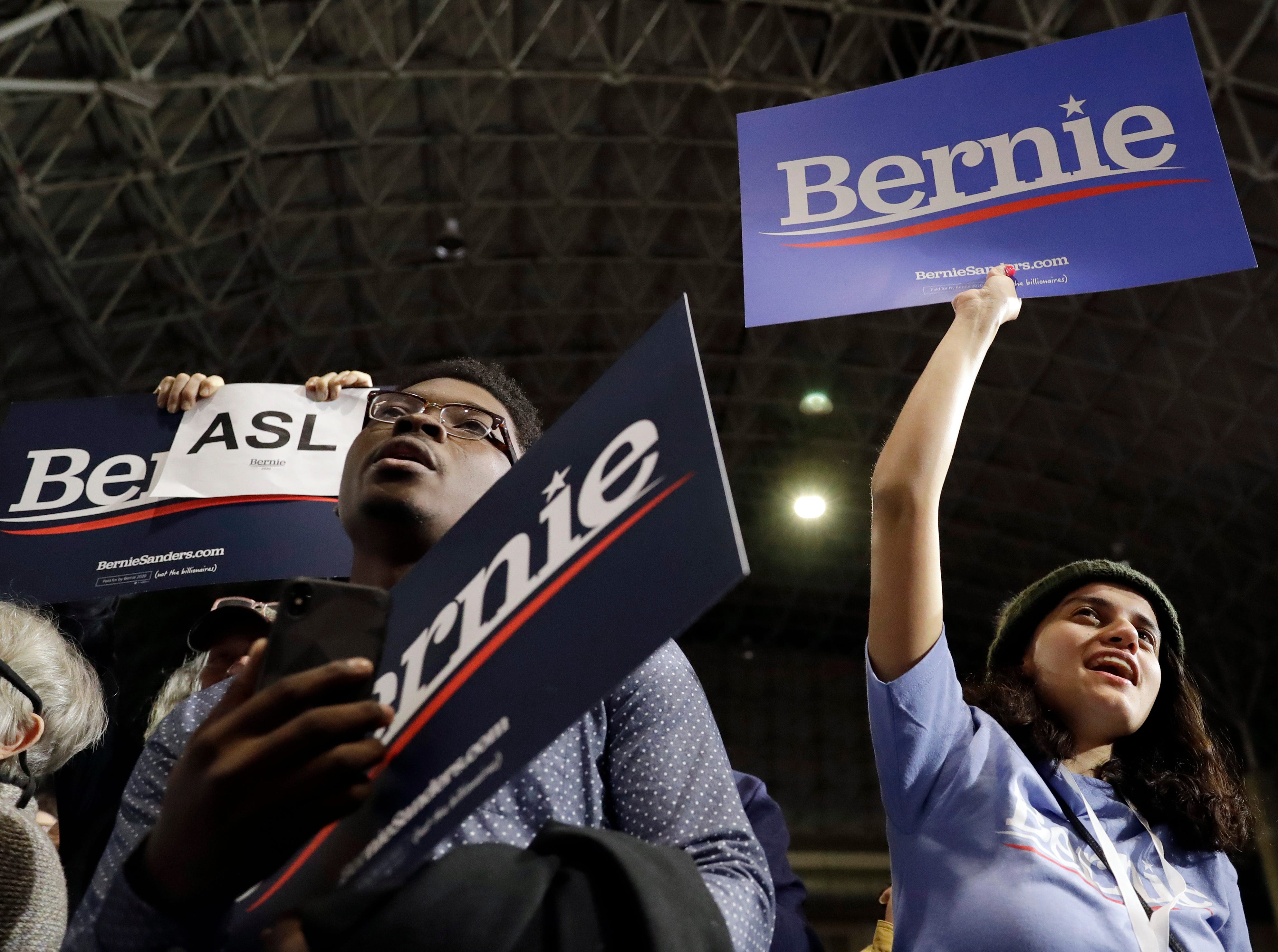 Supporters hold signs as they listen to Sen. Bernie Sanders, I-Vt., where he kicks off his 2020 presidential campaign at Navy Pier in Chicago, Sunday, March 3, 2019. Over the next several weeks, Sanders will travel to Iowa, New Hampshire, South Carolina, Nevada, and California. He will then return to Burlington, Vt., for the official launch of his campaign.