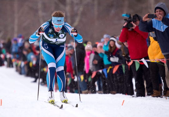 Mount Mansfield's Rose Clayton bears down on the finish line in the girls relay at the Vermont high school Nordic ski championships on Monday in Ripton.
