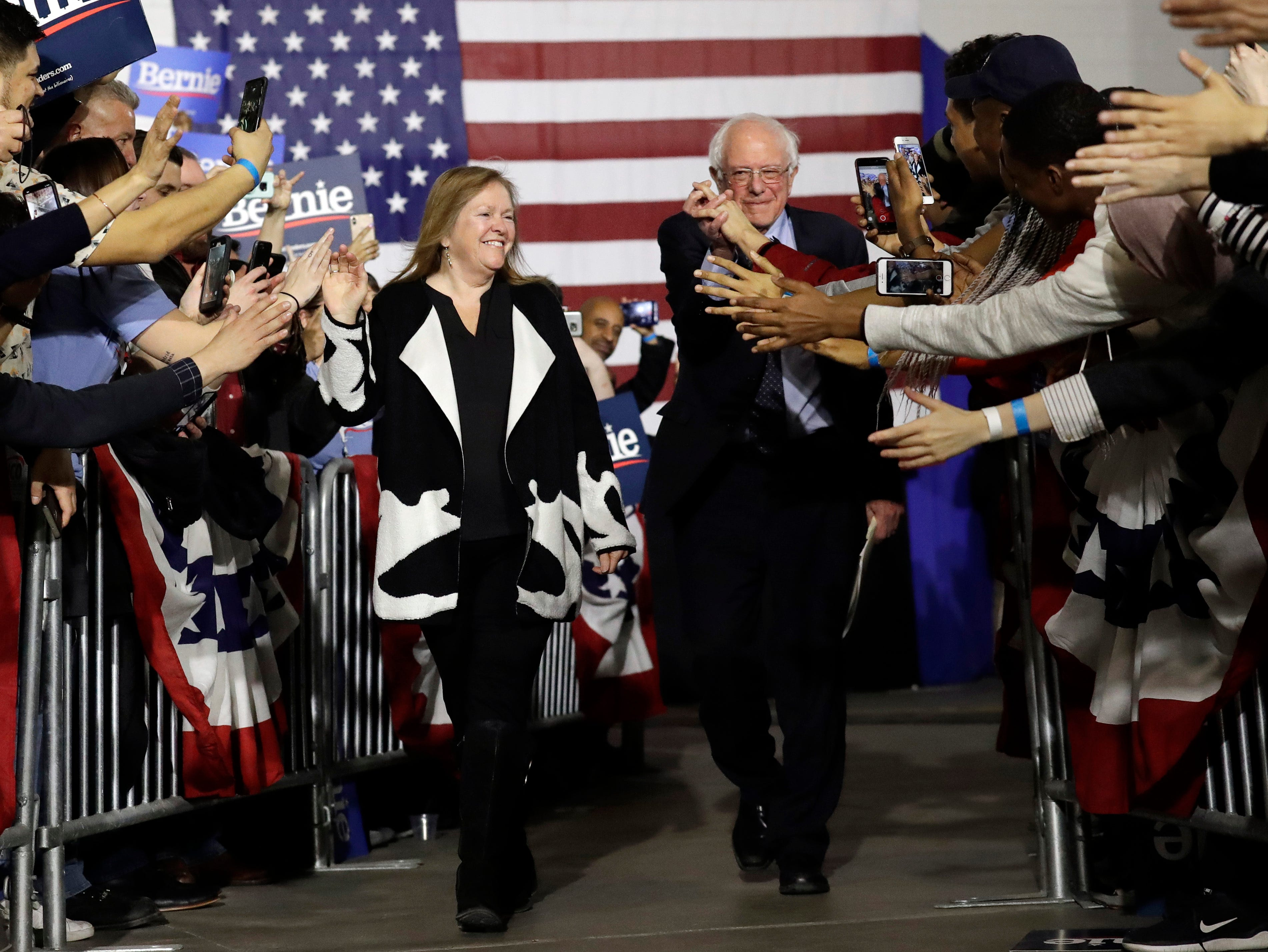Sen. Bernie Sanders, I-Vt., right, and his wife Jane O'Meara Sanders, greet to supporters as they arrive arrive for Bernie Sanders' 2020 presidential campaign at Navy Pier in Chicago, Sunday, March 3, 2019. Over the next several weeks, Sanders will travel to Iowa, New Hampshire, South Carolina, Nevada, and California. He will then return to Burlington, Vermont, for the official launch of his campaign.