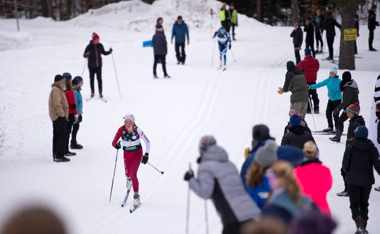 Champlain Valley's Sadie Holmes, left, leads Mount Mansfield's Hattie Barker in the third leg of the girls relay at the Vermont high school Nordic ski championships on Monday in Ripton.
