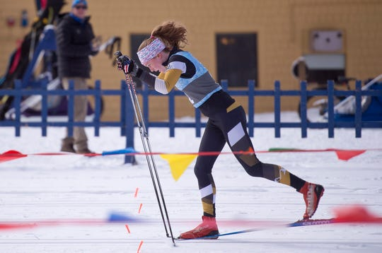 Harwood's Ava Thurston steams toward the finish line to win the girls 5K classic at the Vermont high school Nordic ski championships on Monday in Ripton.