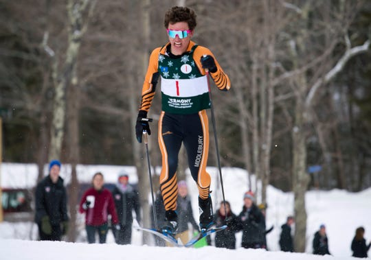 Middlebury's Elvis McIntosh charges up a hill during the boys relay at the Vermont high school Nordic ski championships on Monday in Ripton.