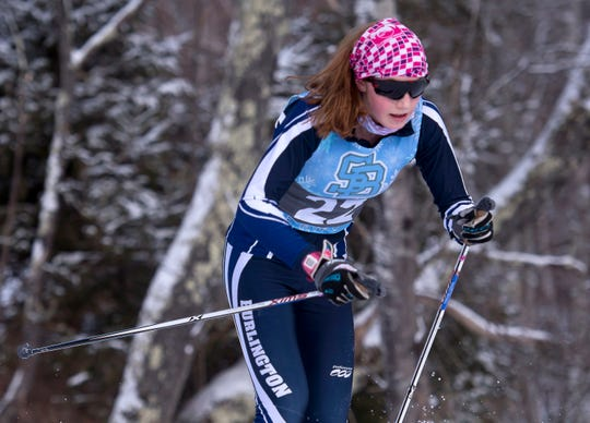 Burlington's Quincy Massey-Bierman nears the finish to win the Division I girls 5K classic at the Vermont high school Nordic ski championships on Monday in Ripton.