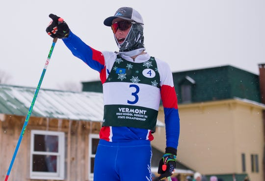 Mount Anthony's Noah Payne reacts after crossing the finish line in the relay at the Vermont high school Nordic ski championships on Monday in Ripton.