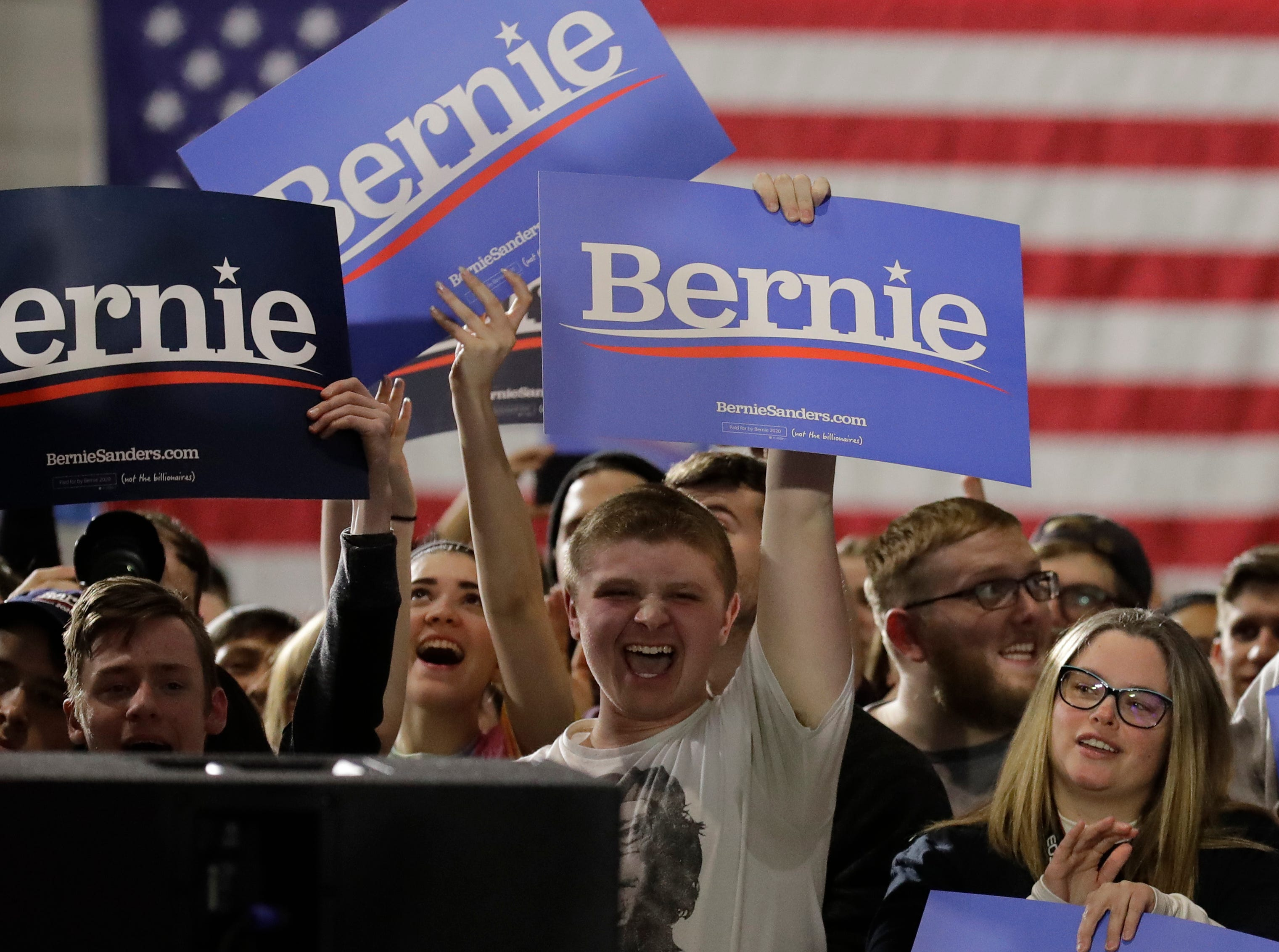 Supporters hold signs as they wait for Sen. Bernie Sanders at 2020 presidential campaign in Chicago, Sunday, March 3, 2019. Over the next several weeks, Sanders will travel to Iowa, New Hampshire, South Carolina, Nevada, and California. He will then return to Burlington, Vermont, for the official launch of his campaign.