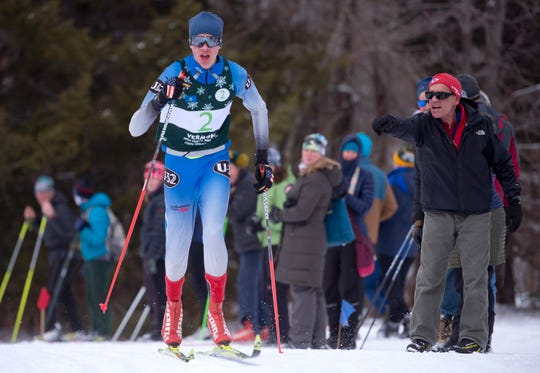 U-32's Samuel Clark climbs a hill in the boys relay at the Vermont high school Nordic ski championships on Monday in Ripton.