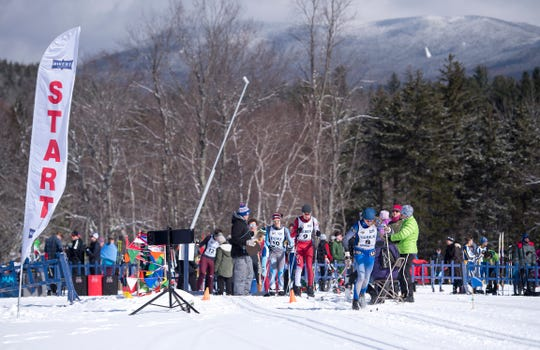 Skiers line up to start the boys 5K classic at the Vermont high school Nordic ski championships on Monday in Ripton.