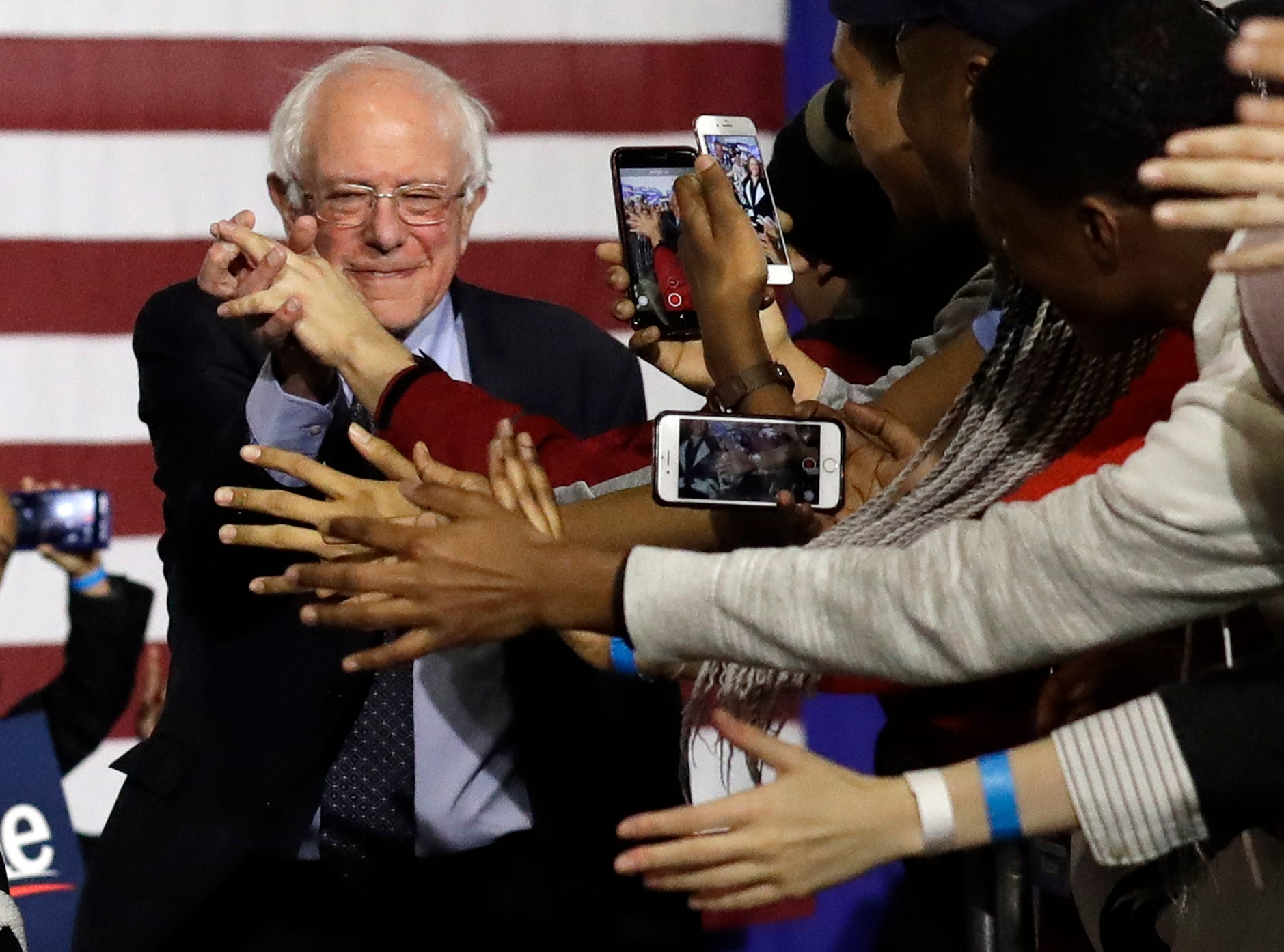 Sen. Bernie Sanders, I-Vt., left, greets supporters as they arrive for his presidential campaign event at Navy Pier in Chicago on Sunday, March 3, 2019. Over the next several weeks, Sanders will travel to Iowa, New Hampshire, South Carolina, Nevada, and California. He will then return to Burlington, Vermont, for the official launch of his campaign.