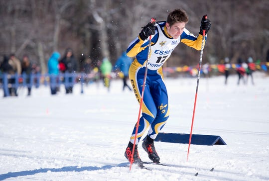 Essex's Charles Martell charges out of the starting gate at the Vermont high school Nordic ski championships on Monday in Ripton.