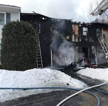 Firefighters, American Red Cross respond to a fire at an Essex condominium on Saturday.
