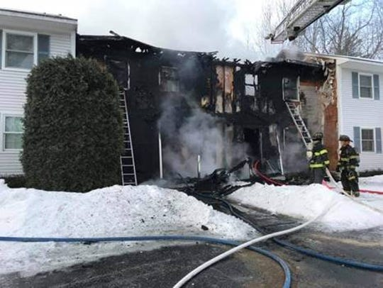 First responders work on fire at Essex home on March 2, 2019.