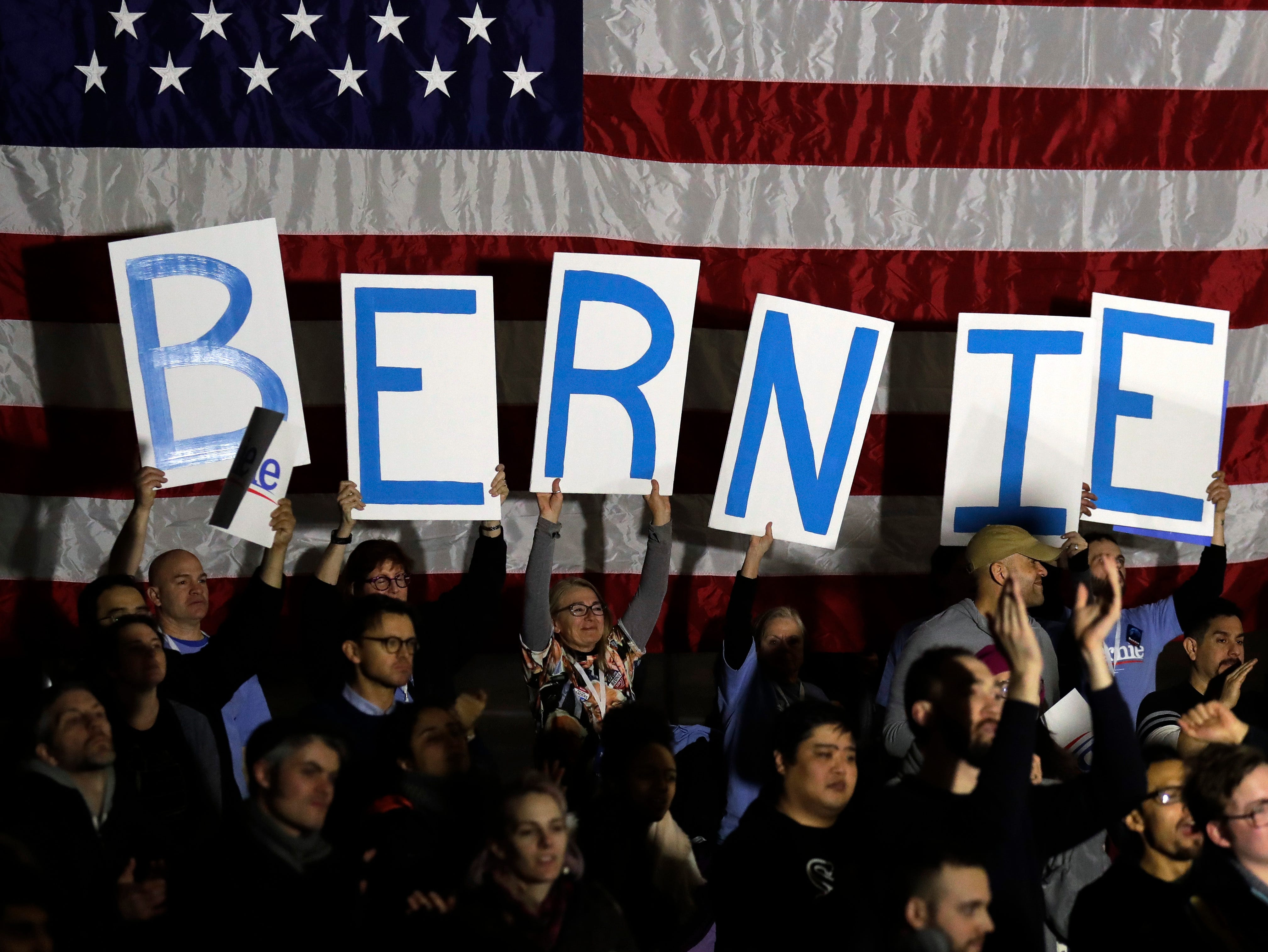 Supporters hold signs as they listen to Sen. Bernie Sanders, I-Vt., during his 2020 presidential campaign at Navy Pier in Chicago, Sunday, March 3, 2019. Over the next several weeks, Sanders will travel to Iowa, New Hampshire, South Carolina, Nevada, and California. He will then return to Burlington, Vt., for the official launch of his campaign.
