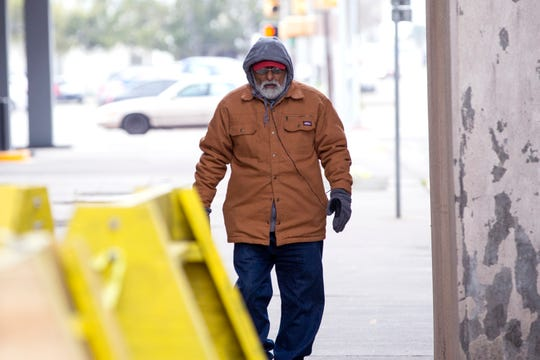A man walks in the Uptown area of Corpus Christi on Monday, March 4, 2019. After a strong cold front moved into the Corpus Christi area Sunday afternoon, temperatures were in the upper 30s Monday morning with wind chills in the 20s.