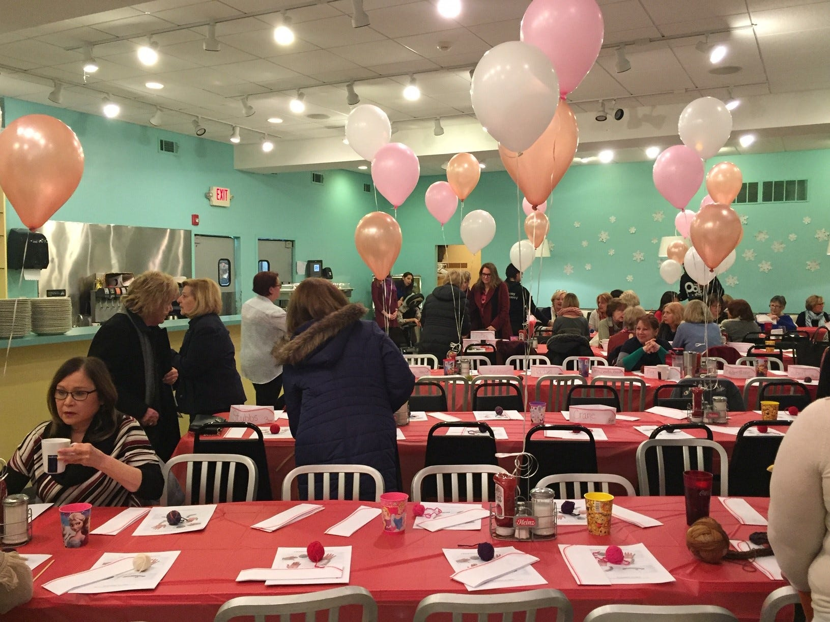 Guests arrive at the Galentine's Celebration at The Pop Shop in Collingswood.