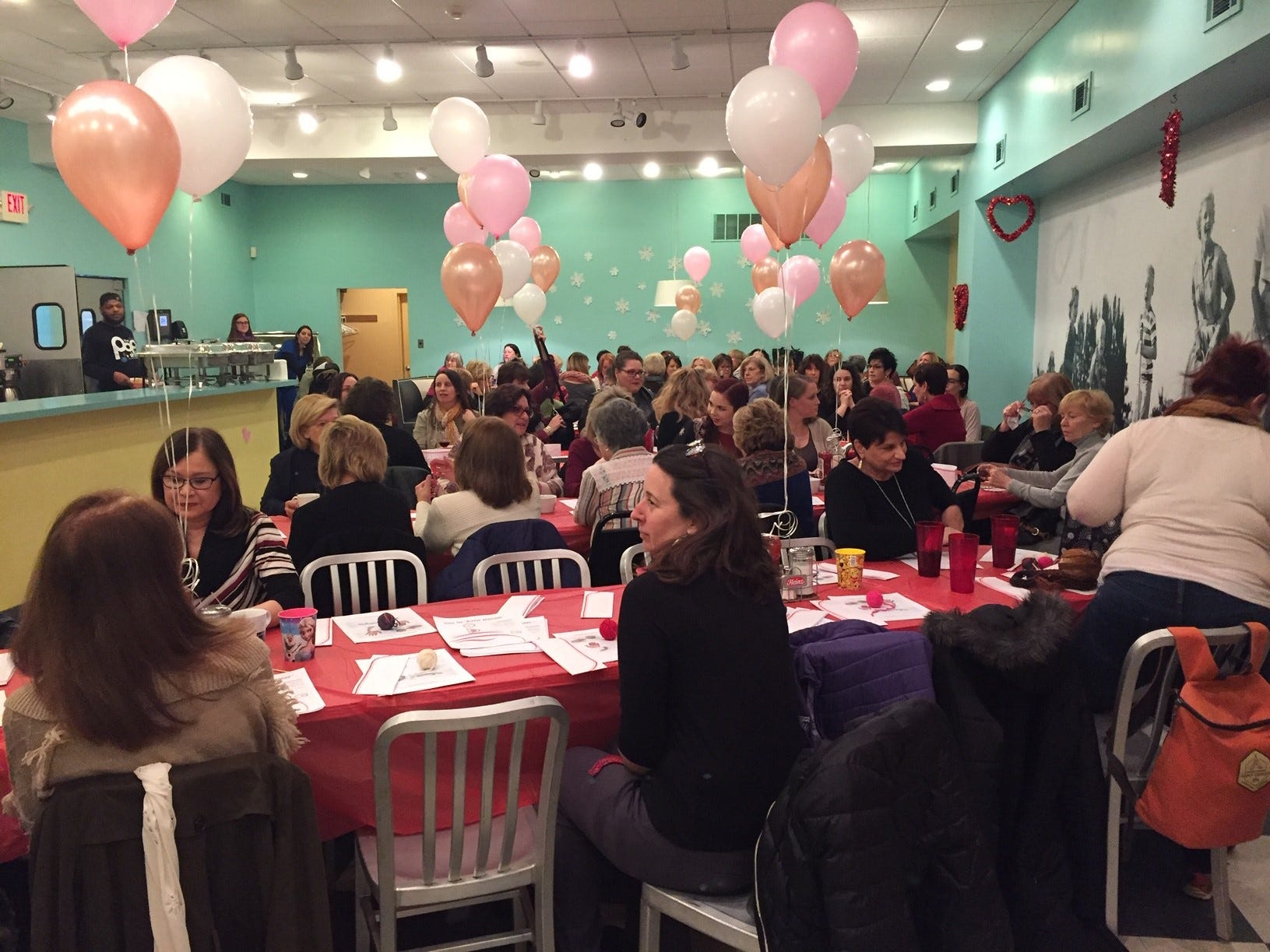 Guests mingle during the Galentine's Celebration at The Pop Shop in Collingswood.