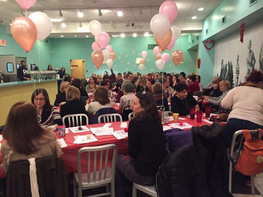 Guests mingle during a Galentine's Celebration at The Pop Shop in Collingswood.