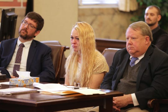 Samantha Davis, 28, pictured Friday, March 1, 2019, sits between her attorneys during her trial in Hamilton County Common Pleas Court. Davis faces aggravated vehicular homicide charges after she is alleged to have been driving a pickup that plummeted from an overpass onto Interstate 71, crushing a car below and killing a woman and her daughter on Aug. 6, 2016.