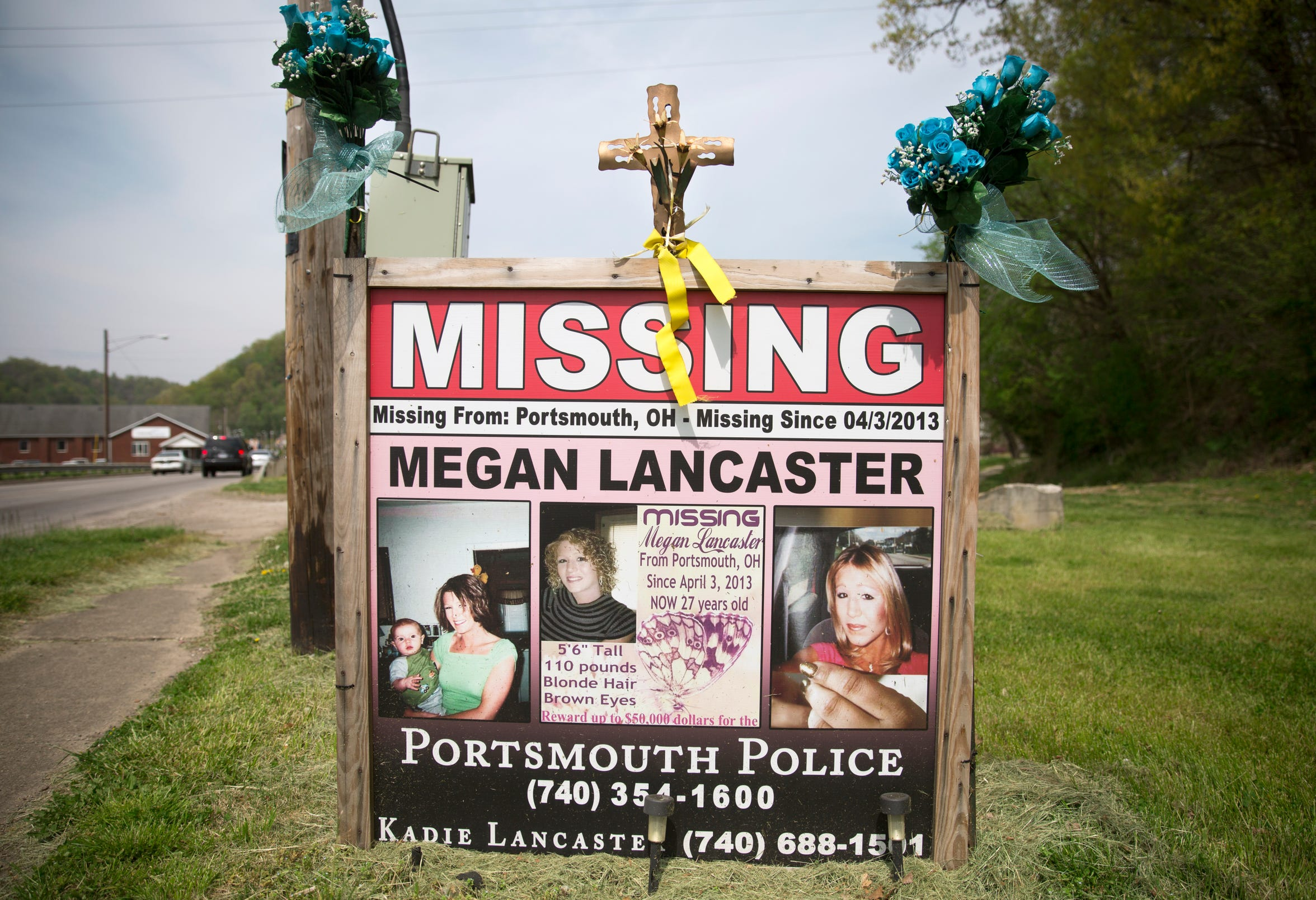 Megan Lancaster went missing in Portsmouth, Ohio in April of 2013. She's never been found. She battled addiction and was an admitted prostitute. Signs like this one in New Boston remind the community of the missing woman.
