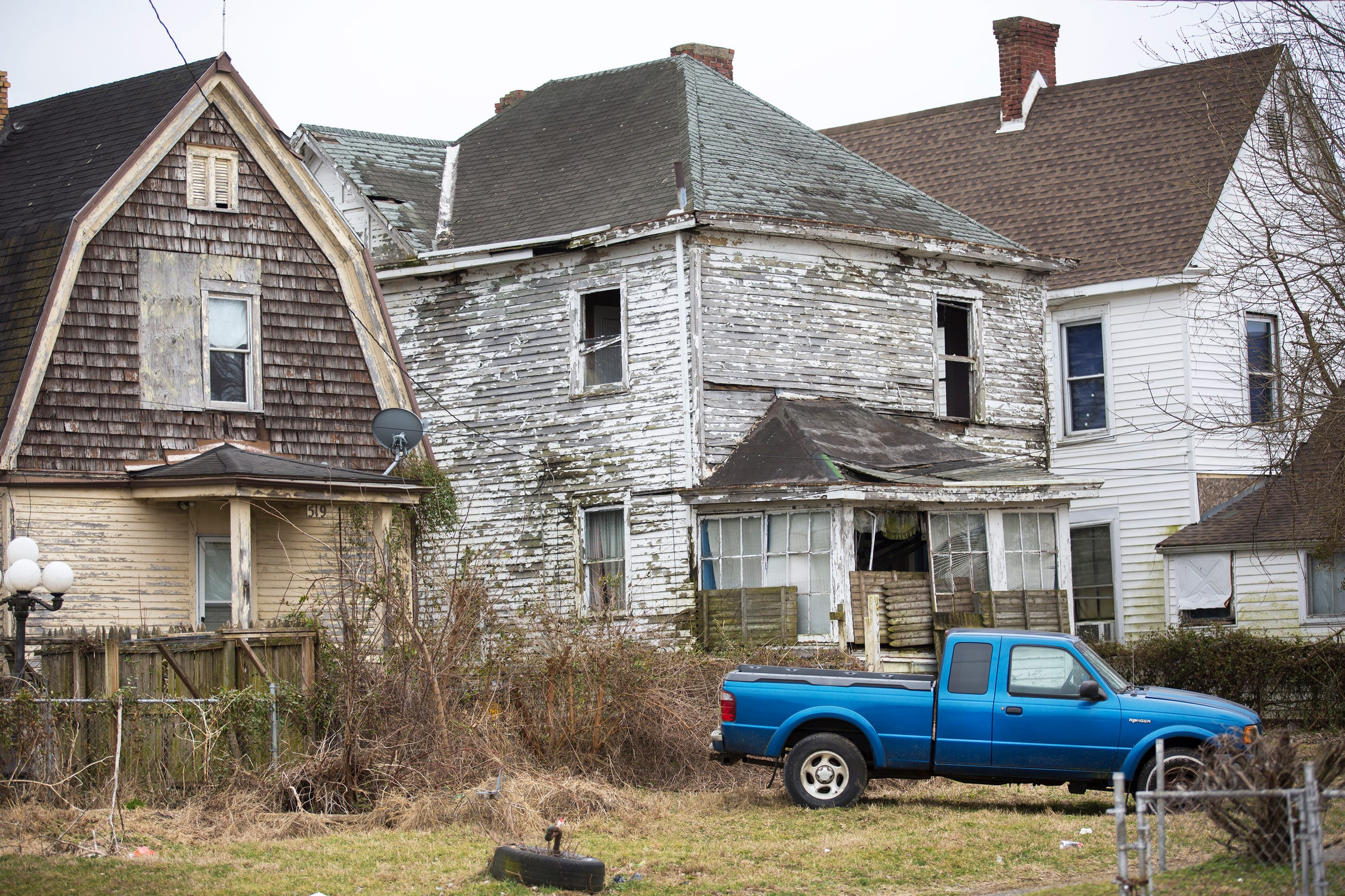 A low income neighborhood in Portsmouth, Ohio. Several of the homes are abandoned and boarded up.