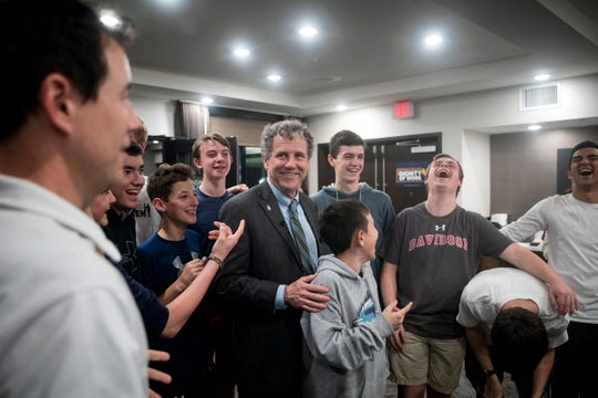 Sen. Sherrod Brown jokes with Durham Academy's tennis team at the Hyatt Hotel in Florence, S.C. Friday, March 1, 2019. Their evening tournament matches were canceled due to rain, so the team listened to Sen. Brown's speech. A few members of the team got stuck on the elevator and missed the speech.