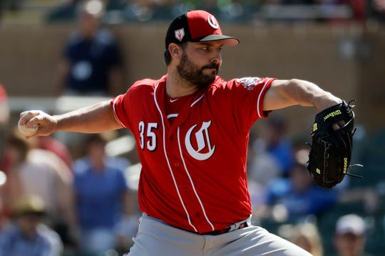 Cincinnati Reds starting pitcher Tanner Roark throws against the Arizona Diamondbacks during the first inning of a spring baseball game in Scottsdale, Ariz., Monday, March 4, 2019.