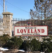 Loveland suspended its public works director for using city equipment on a side job and a second employee for destroying public records after blowing the whistle on the director.