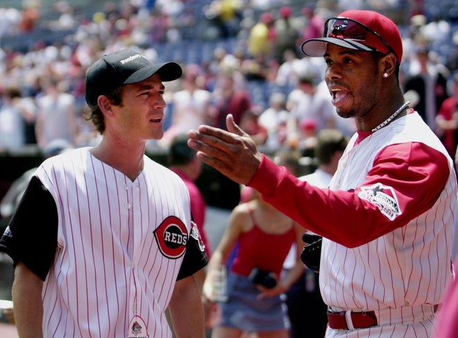 Ohio native, actor Luke Perry talks with Cincinnati Reds' Ken Griffey Jr. before Perry reads the Lou Gehrig's farewell speech prior to the Reds baseball game against Atlanta as part of Project A.L.S. Day, June 1, 2002.