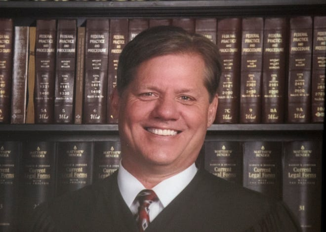 Judge William T. Marshall, now 62, retired from the Scioto County Common Pleas bench in Portsmouth, Ohio in March of 2018. This is part of a larger photograph that hangs in the courthouse of past and present judges.