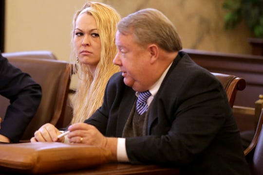 Samantha Davis, 28, pictured Friday, March 1, 2019, is standing trial on aggravated vehicular homicide charges after she is alleged to have been driving a pickup that plummeted from an overpass onto Interstate 71, crushing a car below and killing a woman and her daughter on Aug. 6, 2016. One of her attorneys, Philip Stephens, is at right.