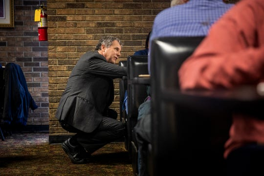 Sen. Sherrod Brown talks to Romana Barker and James Pitts of Loris, S.C. while they eat breakfast at Bazen's Family Restaurant in Florence, S.C. Saturday, March 2, 2019. Brown introduced himself to several diners and talked to them about what struggles they face.