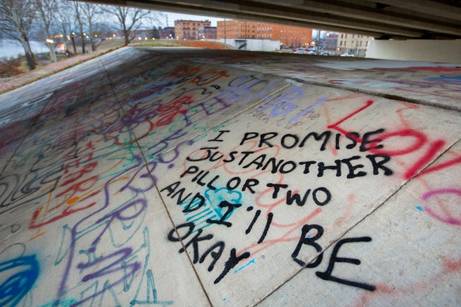 Graffiti under The US Grant Bridge in Portsmouth, Ohio. The bridge empties into the center of Portsmouth, which sits at the intersection of the Ohio River and the Scioto River.