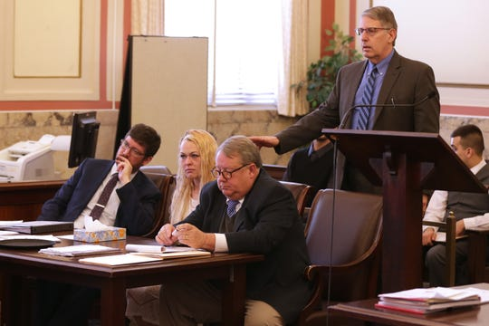 Hamilton County Assistant Prosecutor Seth Tieger, standing, asks a witness to identify Samantha Davis, seated between her attorneys, during testimony Friday, March 1, 2019. Davis faces aggravated vehicular homicide charges after she is alleged to have been driving a pickup that plummeted from an overpass onto Interstate 71, crushing a car below and killing a woman and her  daughter on Aug. 6, 2016.