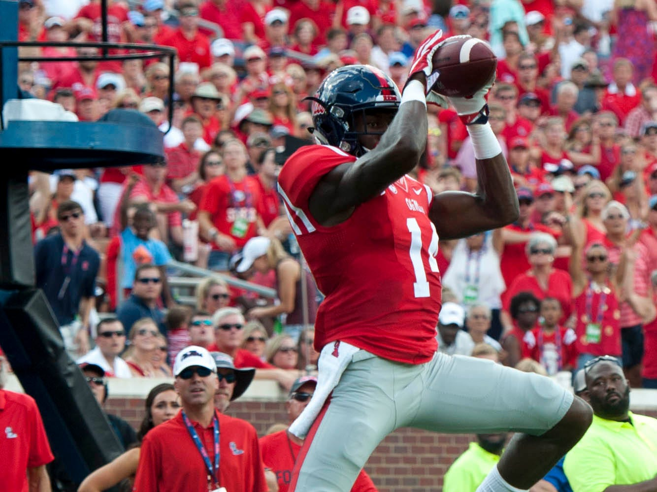 Mississippi Rebels wide receiver D.K. Metcalf (14) catches the ball during the first half thrown by quarterback Chad Kelly (not pictured) against the Wofford Terriers during the first half  at Vaught-Hemingway Stadium. Mississippi Rebels defeats Wofford Terriers 38-13.