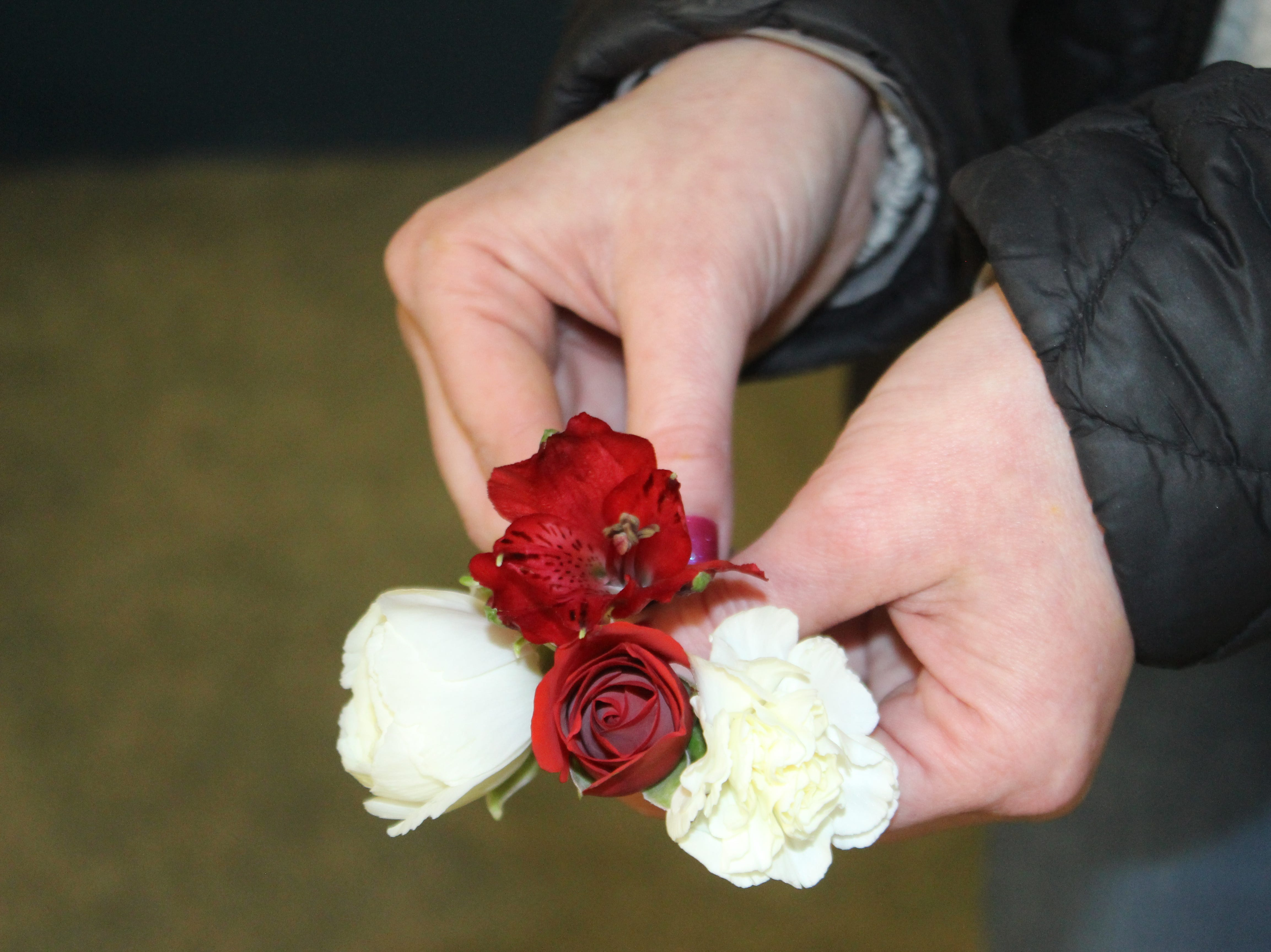 Popular flowers for prom include such choices as spray roses, mini carnations, alstroemeria lilies, and rananculus, shown here by Erica Smith at Hilldale Florist.